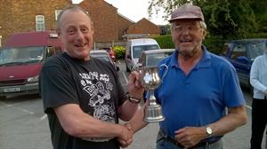 Paul (left) receives the first prize from our Chairman, John.
