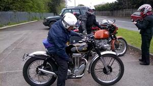 Barrie arrives on his lovely competion AJS.